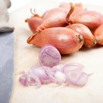 Thinly sliced shallots are the key to quick pickling.