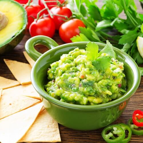 Add your favorite peppers and spices to your guacamole.