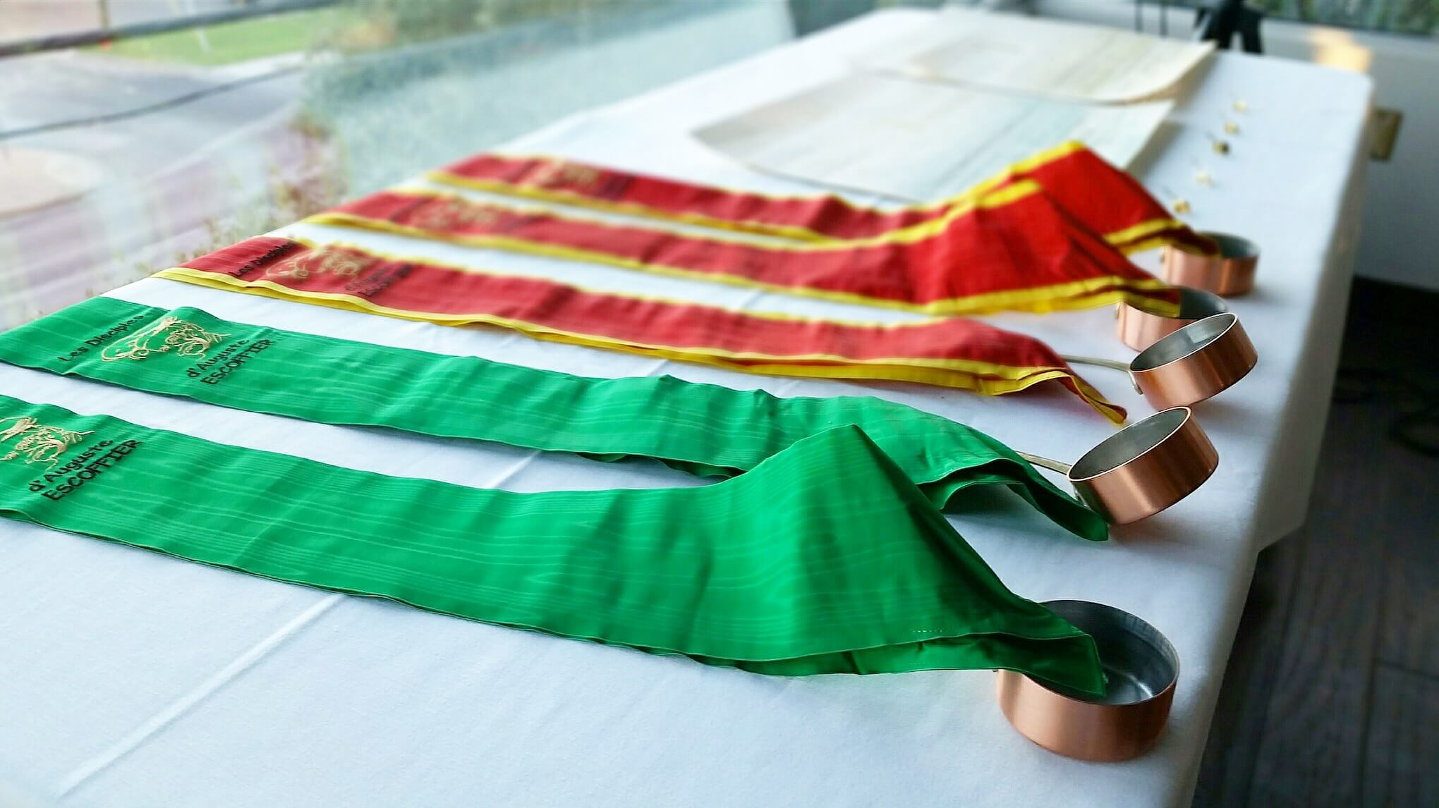 Les Disciples of Escoffier green and red sashes