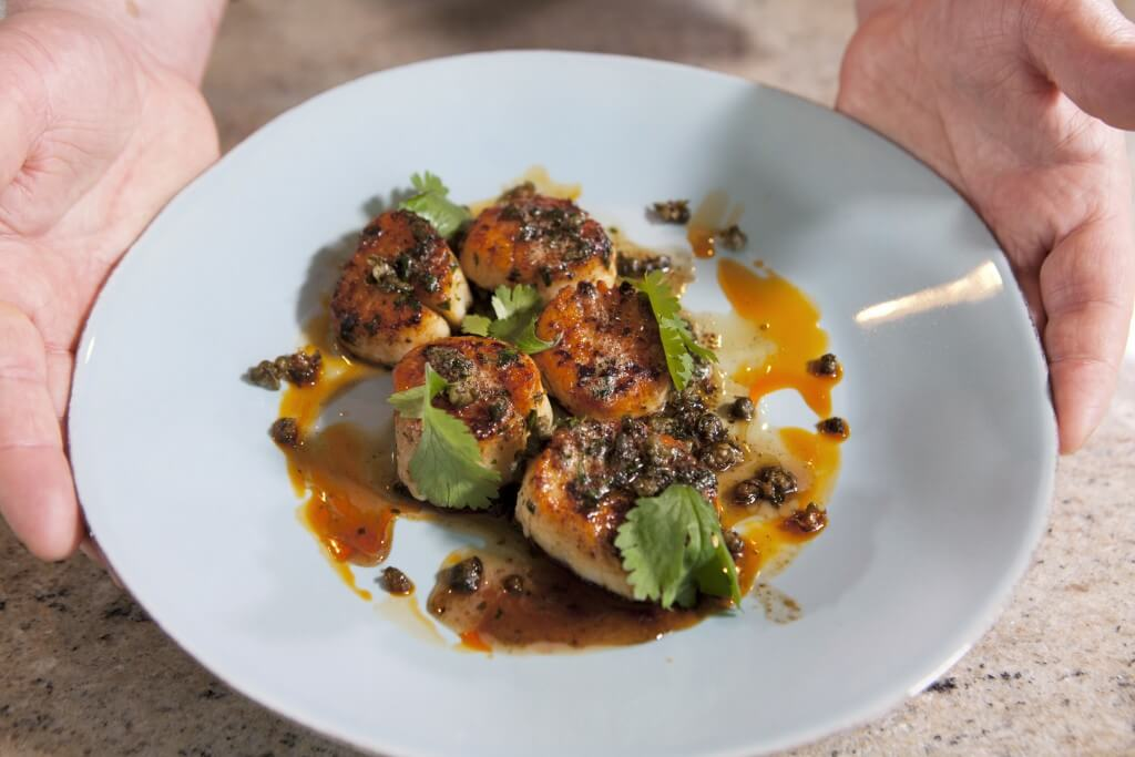 Pair scallops with capers, fresh chopped parsley and browned butter.