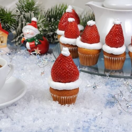 Straberries atop cupcakes make mini Santa hats for your family to enjoy.