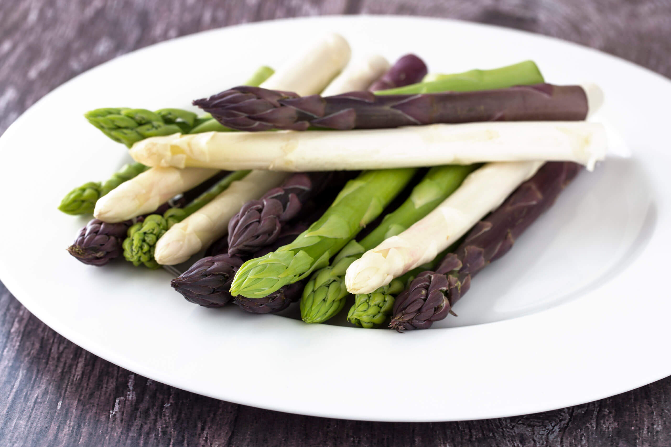 White, Green and Purple Asparagus on White Plate