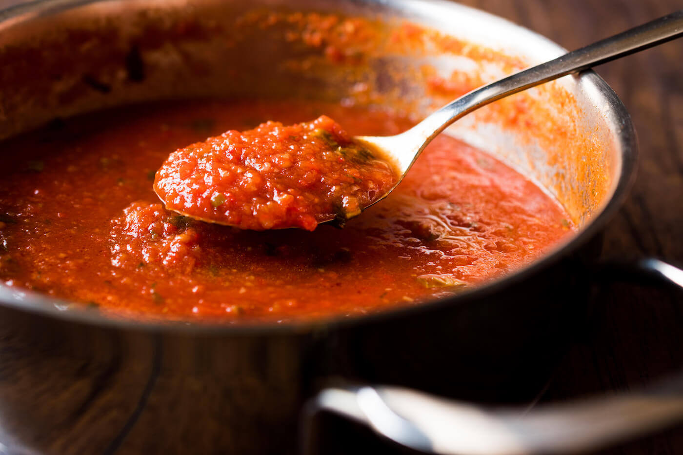 Tomato Sauce with Spoon in Metal Pan